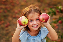 Girl In Apple Orchard. Beautif...