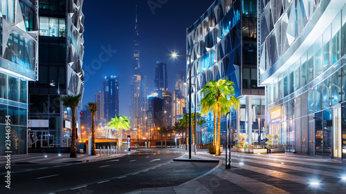 Canvas Print Beautiful view to Dubai downtown city center skyline from Design District at nig