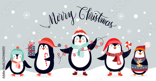 Fototapeta Christmas card design with cute penguins isolated on an winter background obraz