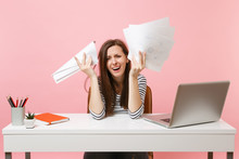 Frustrated Woman In Desperation Crying Spreading Hand Hold Paper Documents Work On Project While Sit At Office With Laptop Isolated On Pink Background. Achievement Business Career Concept. Copy Space.