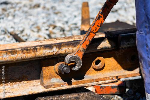 Cuadros en Lienzo Worker tightens the skrew in railway or tram tracks