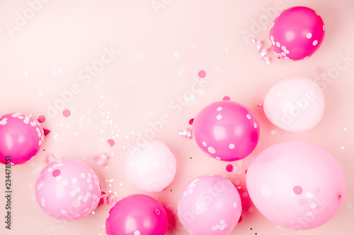 Fotografie, Obraz Pink balloons  with Confetti, bows and paper decorations