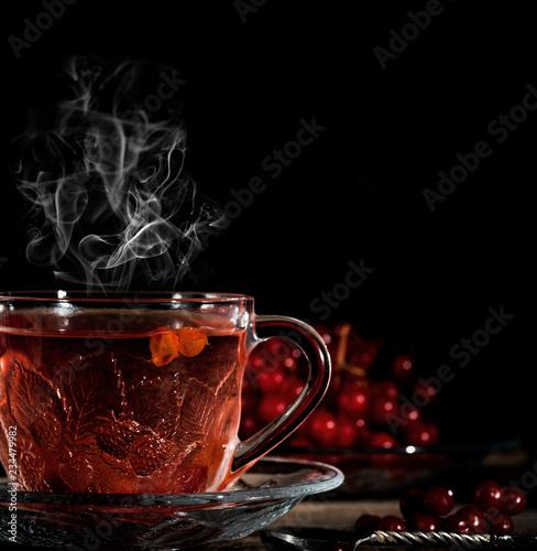 hot viburnum tea in a transparent cup