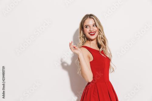Obraz na płótnie Portrait of a smiling young woman in red dress
