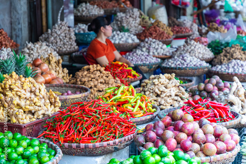 Fresh vegetables and fruits in traditional street market in Hanoi, Vietnam.