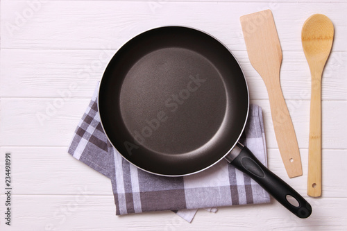 Fotografie, Obraz  frying pan and on the wooden table top view. Cooking.