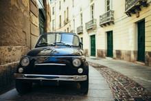 Black Retro Car Parked On Narrow Italy Street In Sardinia Island