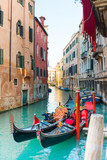 VENICE, ITALY- December 21, 2017 : Tourists on water street with Gondola in Venice,ITALY