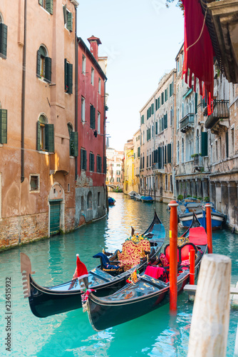 Spoed Fotobehang Venice VENICE, ITALY- December 21, 2017 : Tourists on water street with Gondola in Venice,ITALY