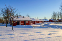 Holiday Cottages In A Winter Landscape