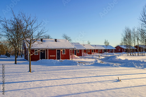 Holiday cottages in a winter landscape Fototapeta