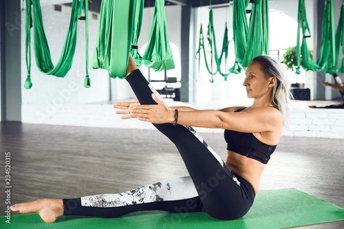 Photo sur Toile Ecole de Yoga Aerial different inversion yoga with a hammock