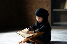 Asian Indonesian Muslim Kid Is...