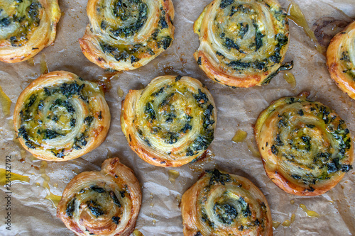 Baked spinach pinwheel puff pastries flat lay Wallpaper Mural