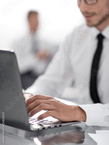 Fototapety, obrazy: Young businessman in formalwear typing on laptop