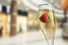 Closeup Of Stylish Champagne Flutes Filled With Chilled Bubbly