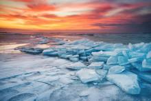 Winter Landscape On Seashore During Sunset. Lofoten Islands, Norway. Ice And Sunset Sky. Natural Winter Landscape