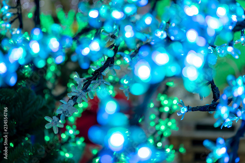 Christmas decorations, neon garlands, glowing flowers, the interior of the new year