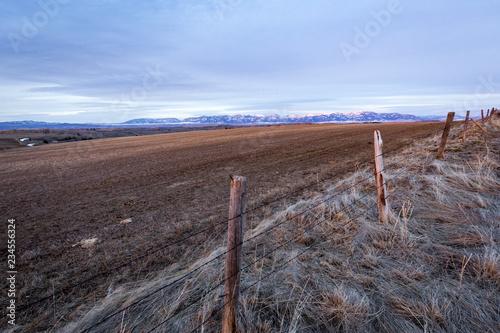 Keuken foto achterwand Cultuur View of field along fence against sky