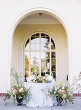 Wedding Reception Table Surrounded By Flowers
