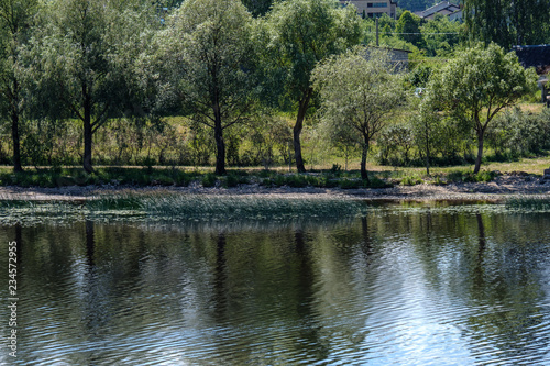 Foto op Aluminium Khaki calm summer day view by the lake with clean water