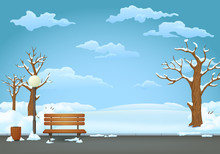 Winter Day In The Park. Wooden Bench With Trash Can And Street Lamp On An Asphalt Trail With Snow Covered Bare Trees And Bushes.