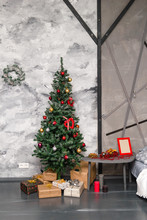 Christmas And New Year Decorated White Interior Room With Presents And New Year Tree With Red Decor Ball