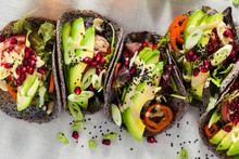 Gluten-free Vegan Tacos From Black Bean  With Tomato And Avocado Salad  With Tahini Sauce And Pomegranate Seeds. Healthy Fast Food For The Whole Family Or Party