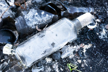 Old Broken Bottles On The Grou...