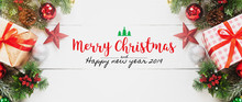 Merry Christmas And Happy New Year 2019 Decorative Gift Box Ornament On White Wood Table Banner Background With Snow Falling.Gifts And Congratulations Holidays Concept.
