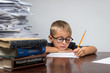 Boy Working on his Stack of Advanced Homework