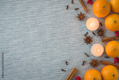 Flat lay seasonal arrangement of oranges, spices, and candles Tablou Canvas