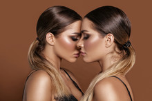 Two Attractive Twins Women In ...