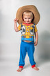 Cute Little Boy in Playing in Cowboy Pajamas