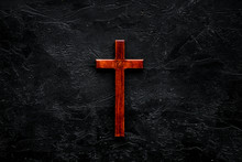 Funeral Concept. Wooden Cross On Black Background Top View Copy Space