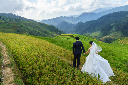 Fotobehang Rijstvelden Terraced rice field in Mu Cang Chai, Vietnam, with happy travel couple