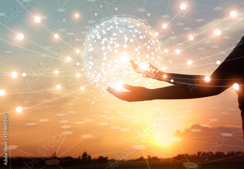 Abstract science, circle global network connection communication in hands on sunset background, technology and innovation.