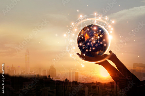 Abstract science, hands touching earth and circle global network connection communication on sunset background, technology and innovation. Elements of this image furnished by NASA