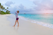 Asian beautiful woman enjoyful traveling sea background.