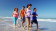 Active multi ethnic college friends keeping fit beside the ocean