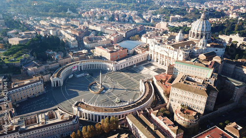 Fototapeta Aerial drone view of Saint Peter's square in front of world's largest church - Papal Basilica of St. Peter's, Vatican - an elliptical esplanade created in the mid seventeenth century, Rome, Italy obraz