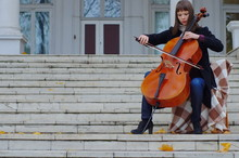 Young Woman Playing Cello On T...
