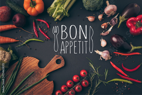 Plakaty do jadalni top-view-of-different-vegetables-and-cutting-board-on-table-with-bon-appetit-lettering