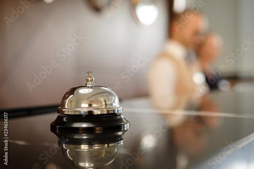 Fototapeta Modern luxury Hotel Reception Counter desk with Bell