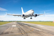 canvas print picture Take off airplane runway in airport to trip.