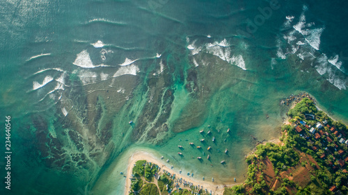 Beautiful aerial view of tropical coastline and fisherman village