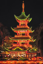 Picture Of Chinese Pagoda With Colorful Lights At Night