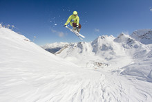 Flying Skier On Snowy Mountain...