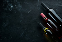 Set A Bottle Of White Wine, Red And Rose Wine On A Black Stone Background. Top View. Free Copy Space.