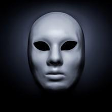 White Mask On A Black Background